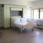 Birth suite with bed, cot & change table